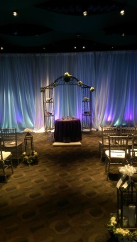 Ceremony piped and draped with lighting